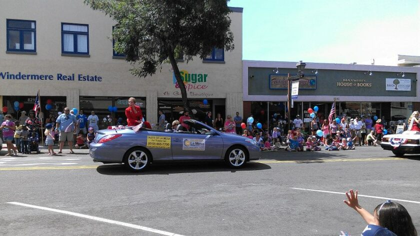 La Mesa Chamber of Commerce President and CEO Mary England in a La Mesa Flag Day Parade several years ago. England and her group are collecting items for seniors for the coming holiday season.