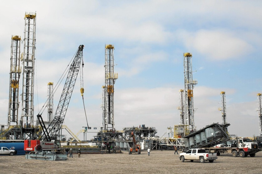 Oil drilling rigs sit idle in the West Texas town of Odessa.