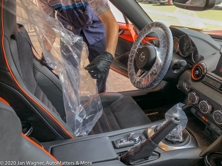 Wrapping the steering wheel, gearshift knob and seat
