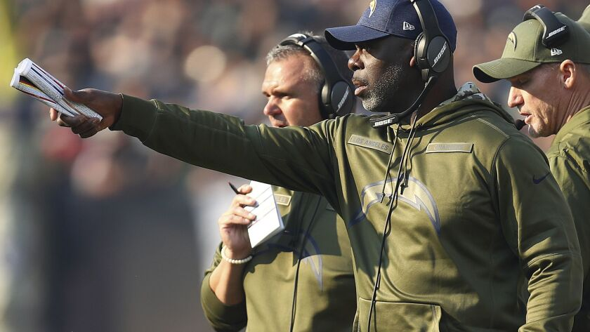 Chargers head coach Anthony Lynn gestures during the first half of a game against the Oakland Raiders in Oakland on Nov. 11, 2018.