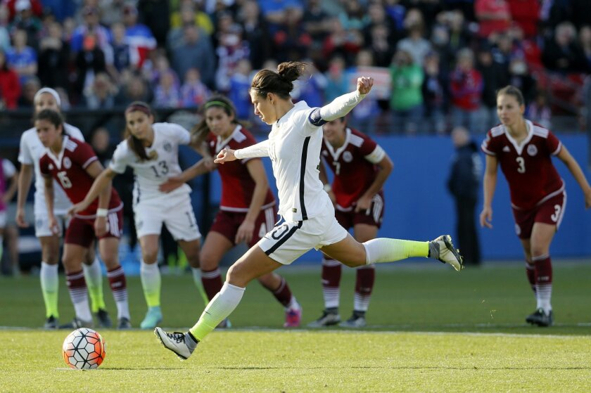 United States midfielder Carli Lloyd (10) charges the ball on a penalty kick against Mexico in the second half of a CONCACAF Olympic qualifying tournament soccer match, Saturday, Feb. 13, 2016, in Frisco, Texas. Lloyd collected her own rebound and scored on the play in their 1-0  win. (AP Photo/Ton