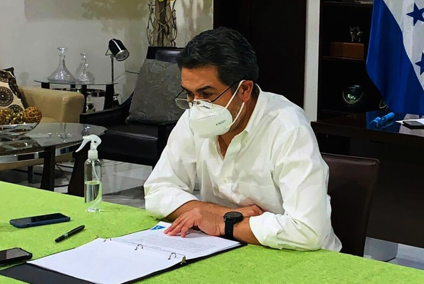 Honduran President Juan Orlando Hernández in a face mask in Tegucigalpa on Monday.