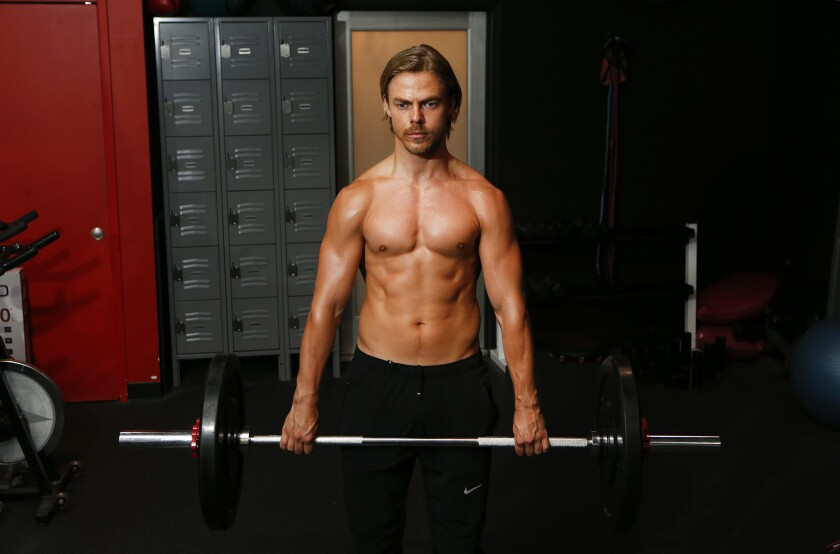 Derek Hough, dancer, choreographer, singer and entertainer, does an exercise to strengthen his back and core muscles at Pulse Fitness Studio in Sherman Oaks on July 29.