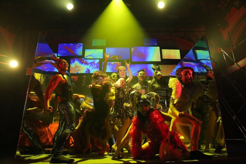 """A scene from the New York production of """"Here Lies Love,"""" which lets playgoers dance among the actors in a disco-like setting."""