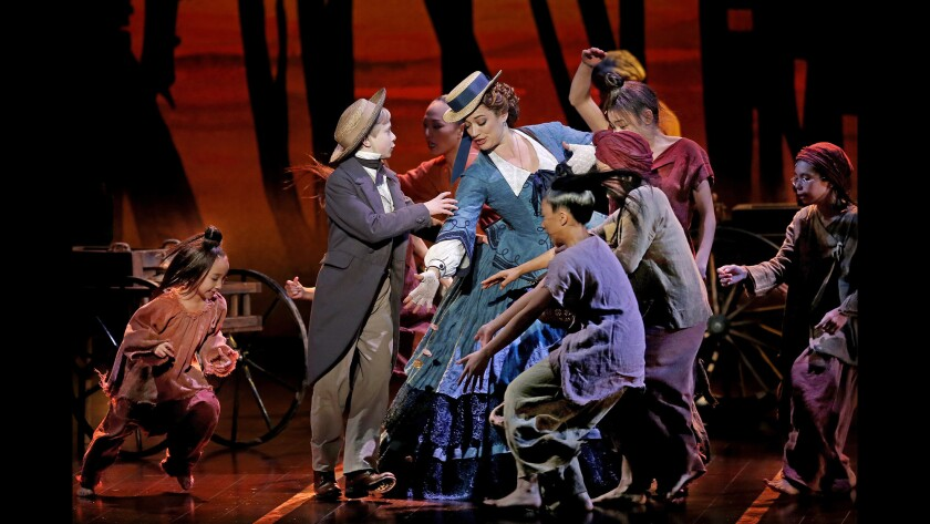 """Graham Montgomery and other child actors perform with Laura Michelle Kelly in """"The King and I"""" at the Pantages Theatre."""
