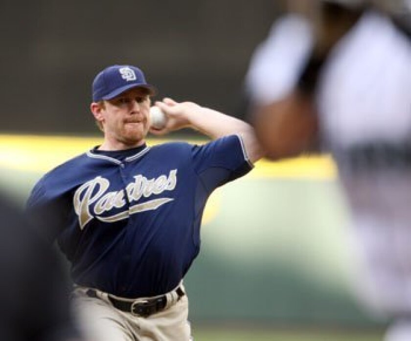 Padres pitcher Randy Wolf throws to Ichiro Suzuki in the first inning against Seattle Friday. AP Photo/Kevin P. Casey