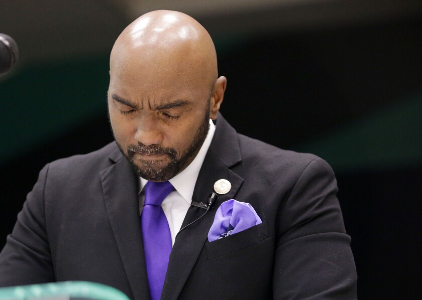 Attorney Damario Solomon-Simmons pauses after becoming emotional during a news conference to discuss a 1921 Tulsa Race Massacre lawsuit Tuesday, Sept. 1, 2020 in Tulsa, Okla. Attorneys for victims and their descendants affected by the 1921 Tulsa Race Massacre have filed a lawsuit in state court against the City of Tulsa and other defendants. The group is seeking reparations for the destruction of the city's once thriving Black district that was burned to the ground by an angry white mob. (Mike Simons /Tulsa World via AP)