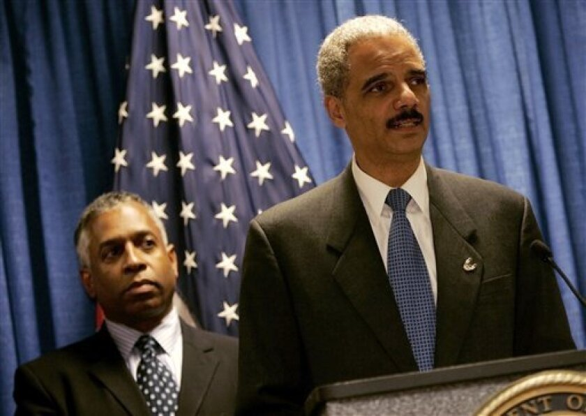 FILE - In this Oct. 29, 2009 file photo, U.S. Attorney General Eric Holder, right, addresses a news conference as U.S. Attorney of Minnesota Todd Jones listens in St. Paul, Minn. Attorney General Eric Holder says a lawsuit in San Francisco over warrantless wiretapping threatens to expose ongoing intelligence work and must be thrown out. (AP Photo/Jim Mone, file)