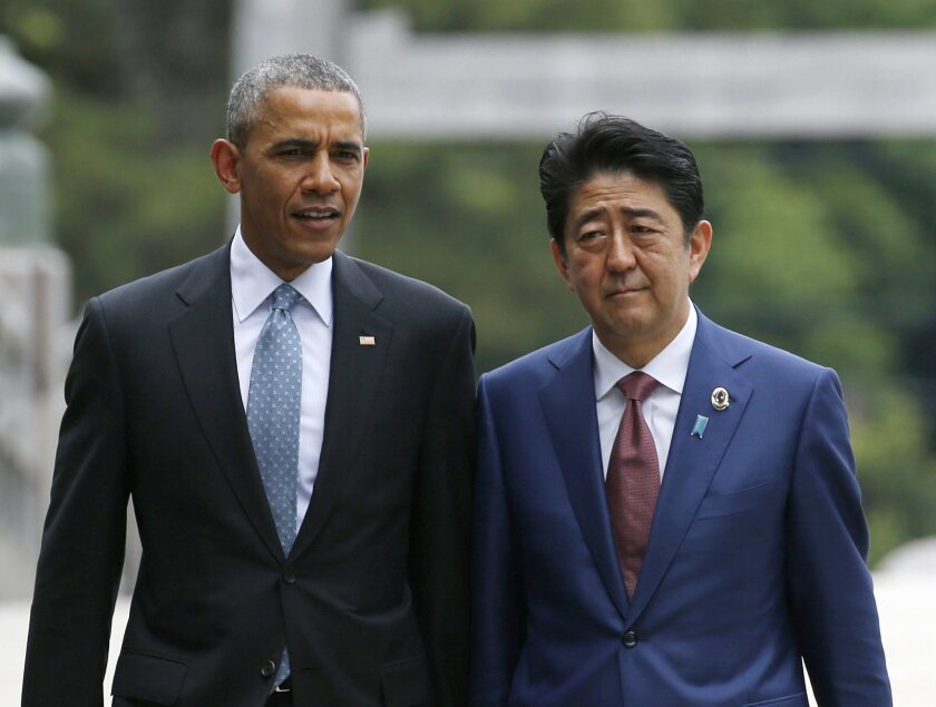 U.S. President Barack Obama, left, talks with Japan's Prime Minister Shinzo Abe on the Ujibashi bridge as they visit the Ise Jingu shrine in Ise, Mie prefecture, Japan Thursday, May 26, 2016, ahead of the first session of the G-7 summit meetings. The leaders of the G-7 nations have arrived for a vi