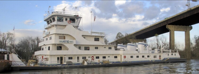 This photo provided by NTSB shows Cooperative Spirit moored after the accident. The National Transportation Safety Board says a fatal head-on crash between two towboats pushing barges in Louisiana was caused by inadequate communication and failure to broadcast their total sizes. The RC Creppel overturned and sank after the collision with the Cooperative Spirit in January 2020. Its pilot, captain and one of two crewmen were never found. (NTSB via AP)