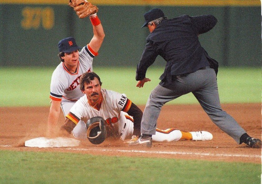 Marty Castillo completes tag, umpire Rich Garcia calls Padres Kurt Bevacqua is out at third base as the Tigers' Marty Castillo applies the tag and umpire Rich Garcia makes the call on a crucial play in Game 1 of the '84 World Series.