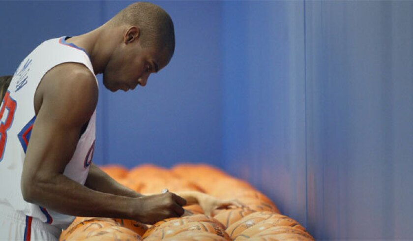 Antawn Jamison signs basketballs during Clippers media day last September in Playa Vista.