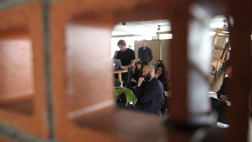 Architect Francisco Pardo (seated, with beard), of Mexico City's Universidad Iberoamericana, listens to student presentations at a joint studio session with SCI-Arc.