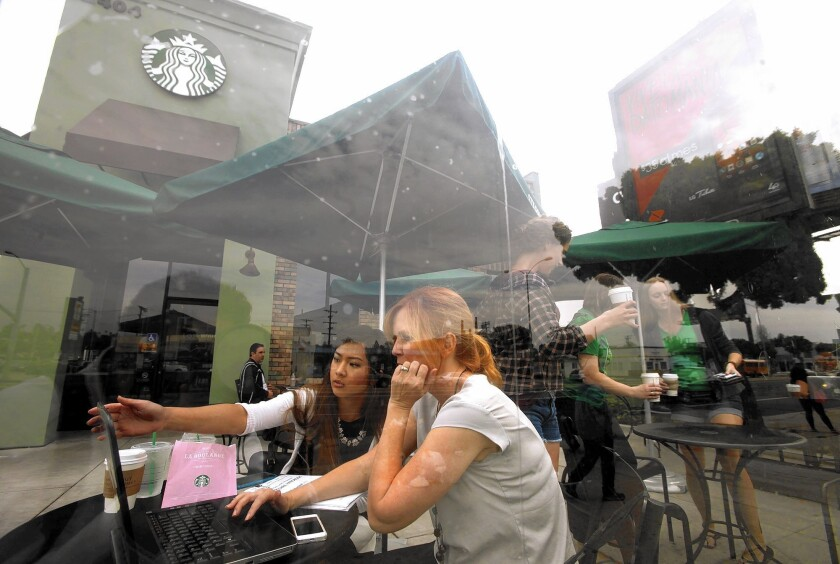 """Starbucks this week began encouraging its baristas to write the words """"Race Together"""" on cups to get its customers talking about race. Above, customers outside a shop in Mar Vista."""