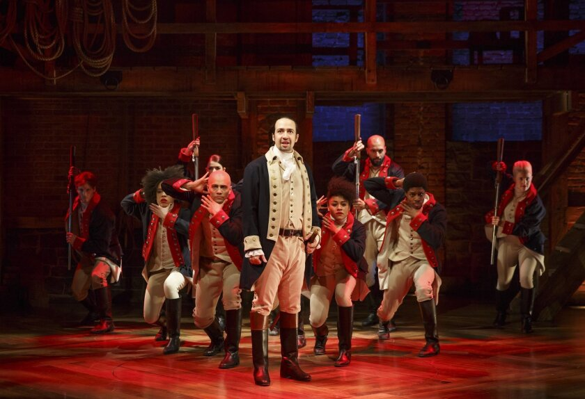 """In this image released by The Public Theater, Lin-Manuel Miranda, center, performs in the musical """"Hamilton"""" in New York. Bloomingdale's said Friday it will carry """"Hamilton"""" memorabilia in its stores in Chicago, Los Angeles, San Francisco, Santa Monica and New York's Long Island, as well as online. That's in addition to the retailer's two Manhattan locations on 59th Street and SoHo. Bloomingdale's is the exclusive retailer beginning June 1 through July 31. (AP Photo/The Public Theater, Joan Marcus)"""