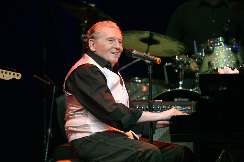 """Rock 'n' roll pioneer Jerry Lee Lewis, shown performing in Las Vegas in 2009, is back with a new album, """"Rock & Roll Time,"""" including guests Neil Young, Keith Richards, Ron Wood and Robbie Robertson, and is the subject of a new biography """"Jerry Lee Lewis: His Own Story"""" by author Rick Bragg."""