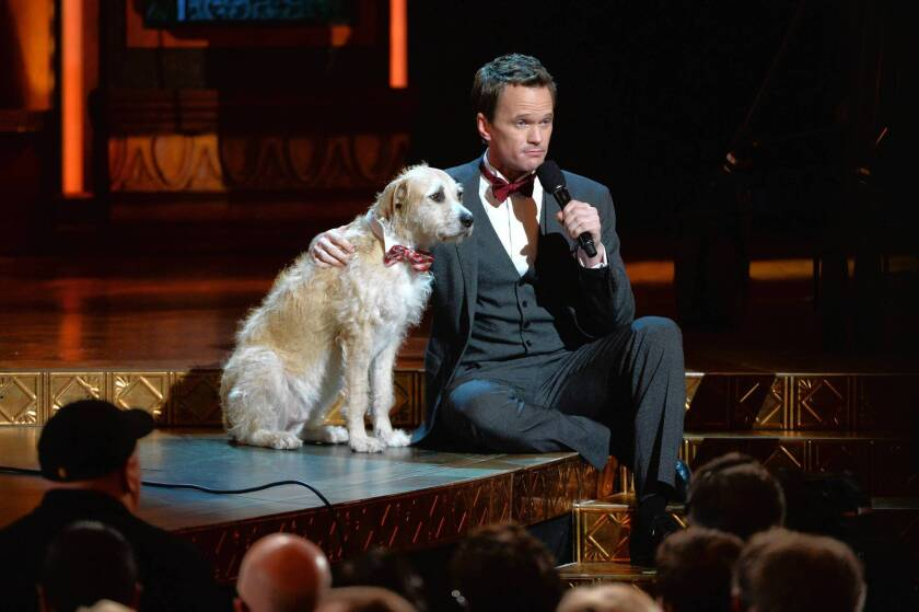 "Host Neil Patrick Harris and Sandy from ""Annie."""