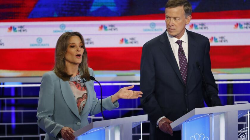 Democratic presidential candidate author Marianne Williamson, speaks as former Colorado Gov. John Hi