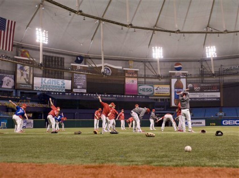 Philadelphia Phillies players stretch during their workout at Tropicana Field in St. Petersburg, Fla., Monday, Oct. 20, 2008. The Philadelphia Phillies will meet the Tampa Bay Rays in Game 1 of the World Series on Wednesday, Oct. 22. (AP Photo/Steve Nesius)
