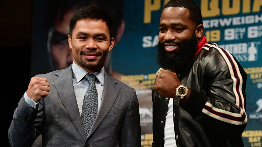 Manny Pacquiao, left, and Adrien Broner promote their upcoming bout on Tuesday in New York City. The fight is set to take place on Jan. 19, 2019 in Las Vegas.