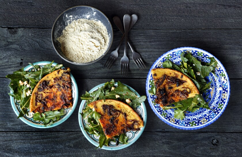 North African chickpea pancakes with harissa tossed bitter greens.