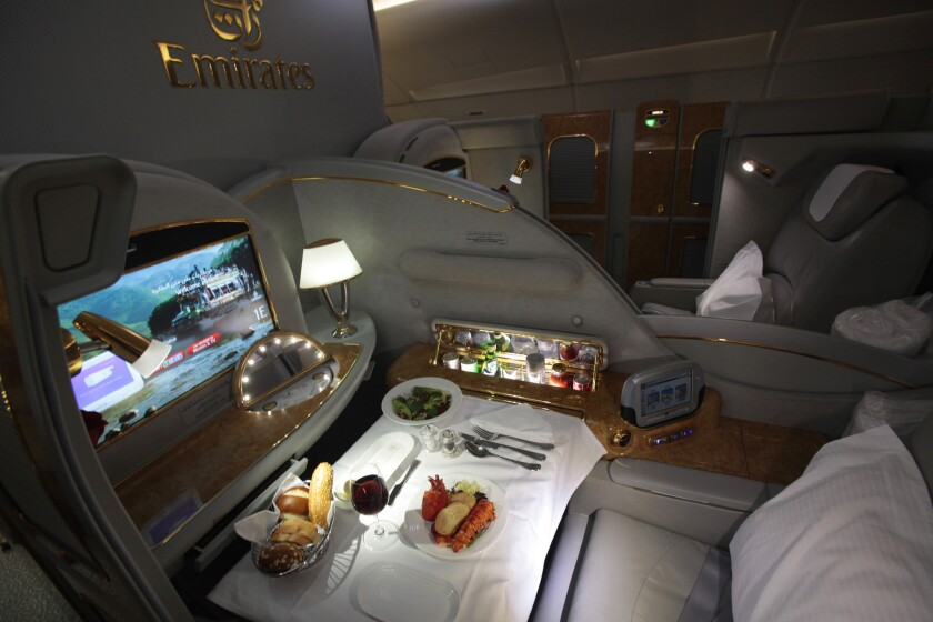 Pay enough on our Air Gini, and your flight experience might match this first-class layout on Emirates Airlines, with a personal mini-bar and reclining seat which turns into a bed.