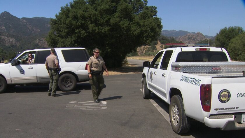 Investigators on scene at Malibu State Creek Park where a father was fatally shot inside his tent wh