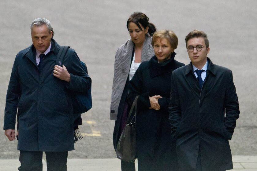 Alexander Litvinenko's widow, Marina, center right, and son Anatoly, right, arrive at the High Court in London to receive the results of the inquiry into the former agent's death.