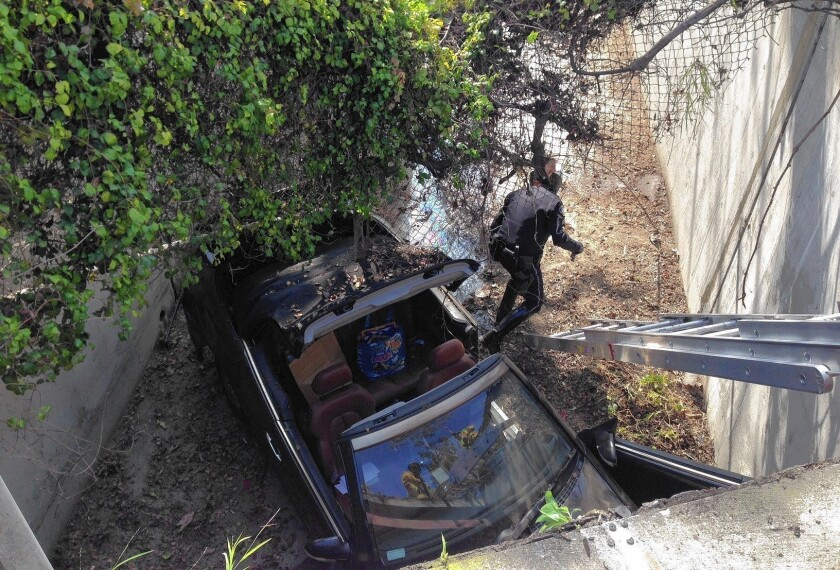 Driver backs car into storm channel