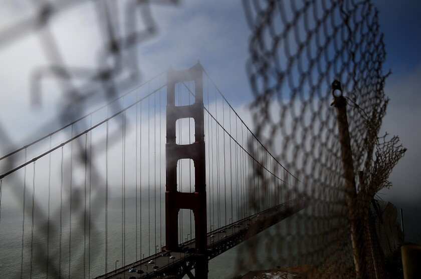 The north tower of the Golden Gate Bridge is viewed through a fence in Sausalito in this 2014 file photo.