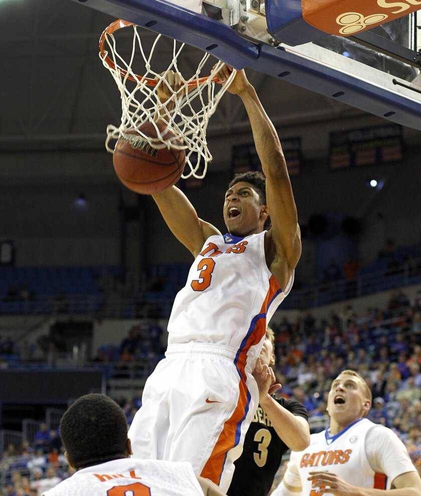 Florida forward Devin Robinson (3) dunks against the Vanderbilt during the second half at the Stephen C. O'Connell Center on Wednesday, Feb. 18, 2015 in Gainesville, Fla. Florida defeated Vanderbilt 50-47. (AP Photo/The Gainesville Sun, Matt Stamey) THE INDEPENDENT FLORIDA ALLIGATOR OUT
