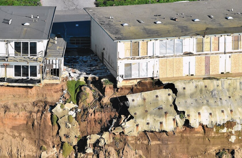 Apartments are seen at the edge of a cliff in Pacifica, Calif. Residents have been forced to evacuate as storms and powerful waves caused by El Niño have been intensifying erosion along coastal bluffs.