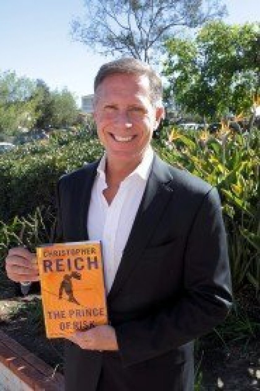 """Author Christopher Reich with his new book """"The Prince of Risk."""" Photo/Jon Clark"""