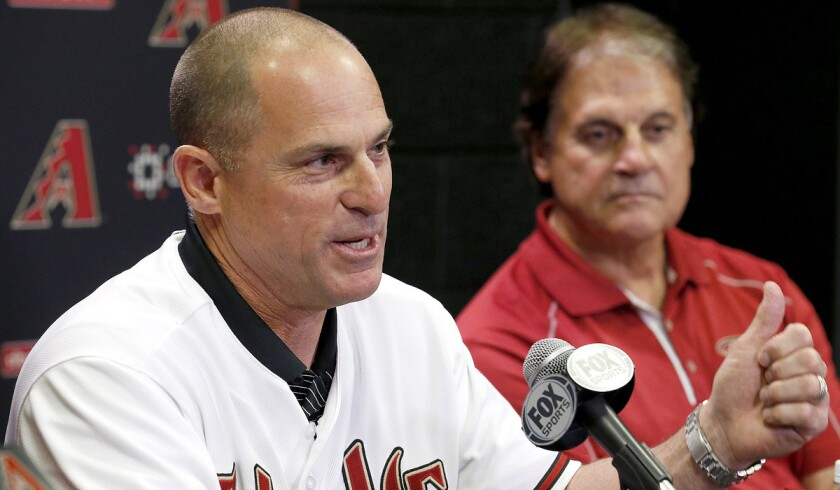 Chip Hale, alongside Chief Baseball Officer Tony La Russa, fields questions from the media as he's introduced as the manager of the Arizona Diamondbacks on Oct. 13, 2014.