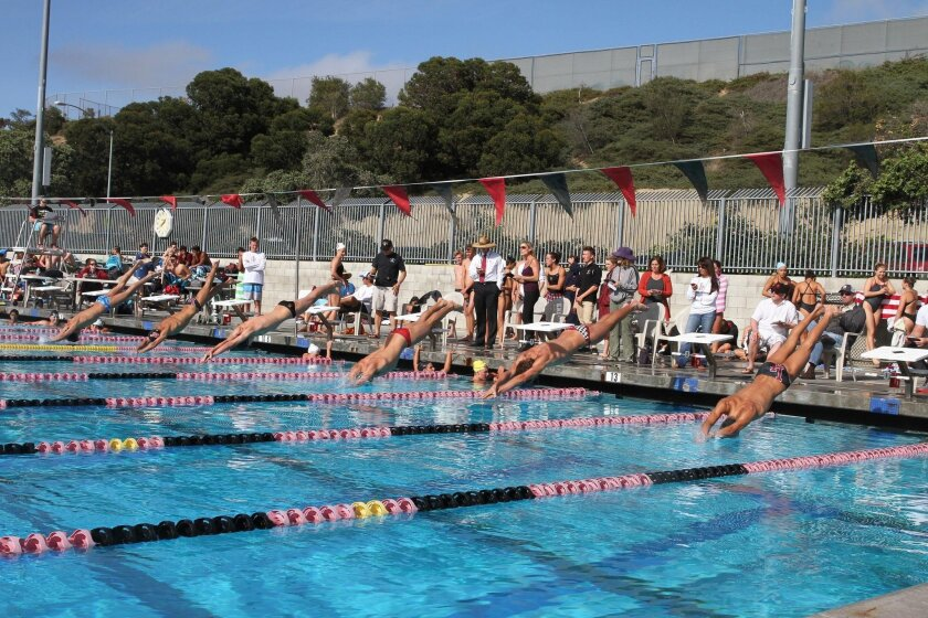 Members of the Bishop's and La Jolla boys swim teams dive in to start a race April 22 at Coggan Family Aquatic Complex. The Vikings won both the boys and girls competitions.