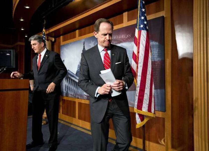 Republican Sen. Patrick J. Toomey of Pennsylvania, right, and Democratic Sen. Joe Manchin III of West Virginia finish a Capitol Hill news conference to announce that they had reached a compromise on gun control legislation.