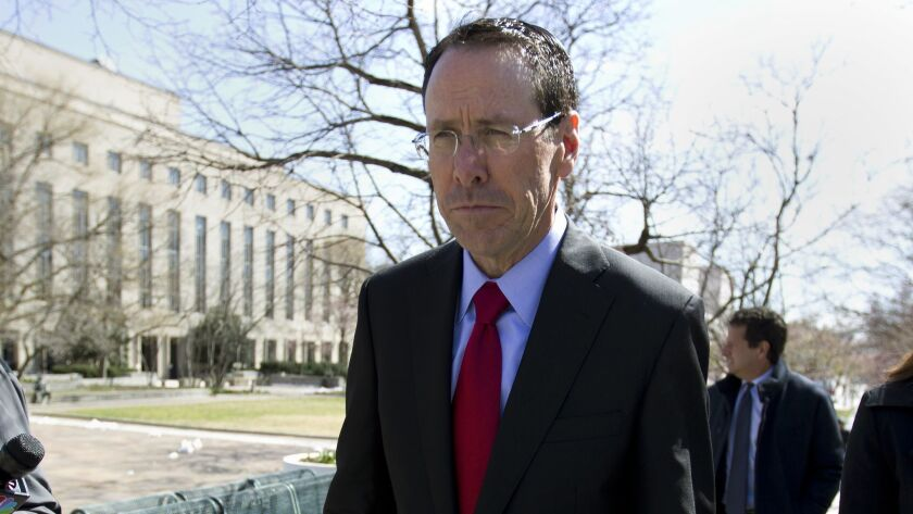 AT&T Inc. Chief Executive Randall Stephenson leaves a federal courthouse in Washington on Thursday after listening to opening arguments in the Justice Department antitrust suit to block the company's purchase of Time Warner Inc.