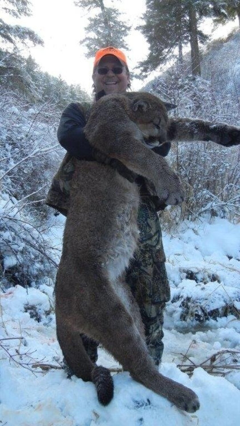 Dan Richards drew heat for posing with this mountain lion he shot legally on a hunt in Idaho. He was voted out Wednesday as president of the Fish and Game Commission in Ventura.