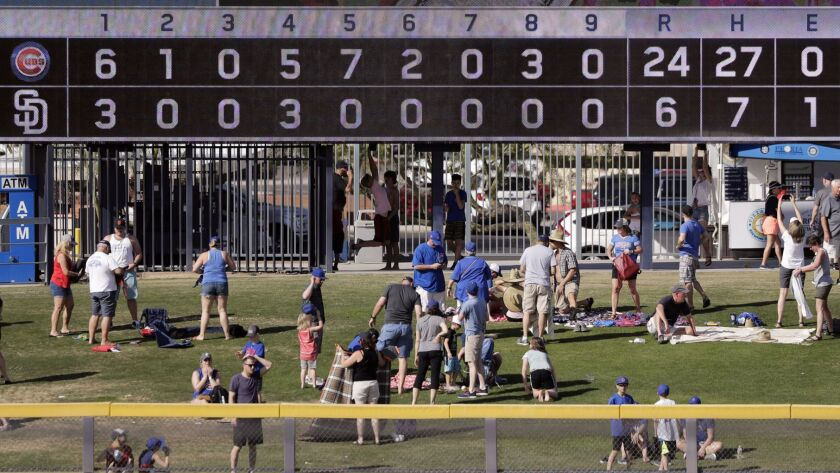Fans pack up at the end of a spring training baseball game between the San Diego Padres and the Chic