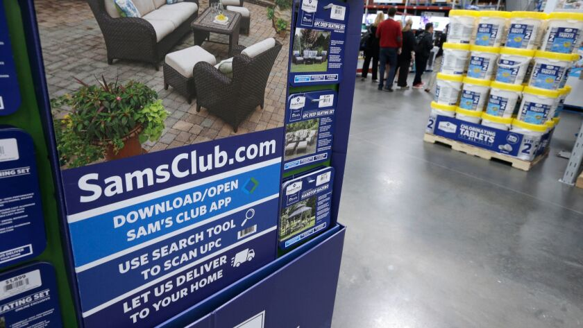 FILE- In this June 4, 2015, file photo, a sign encouraging shoppers to use a Sam's Club phone app is