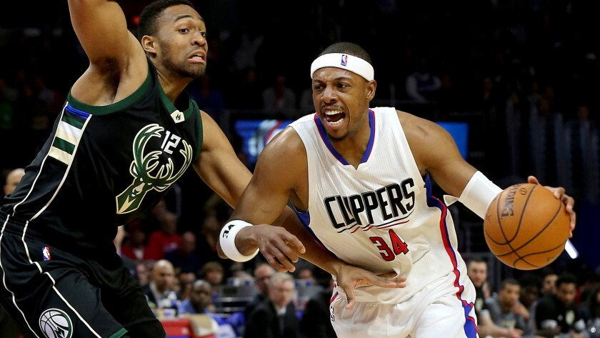 Clippers forward Paul Pierce drives to the basket against Bucks forward Jabari Parker during a game Dec. 16 at Staples Center.