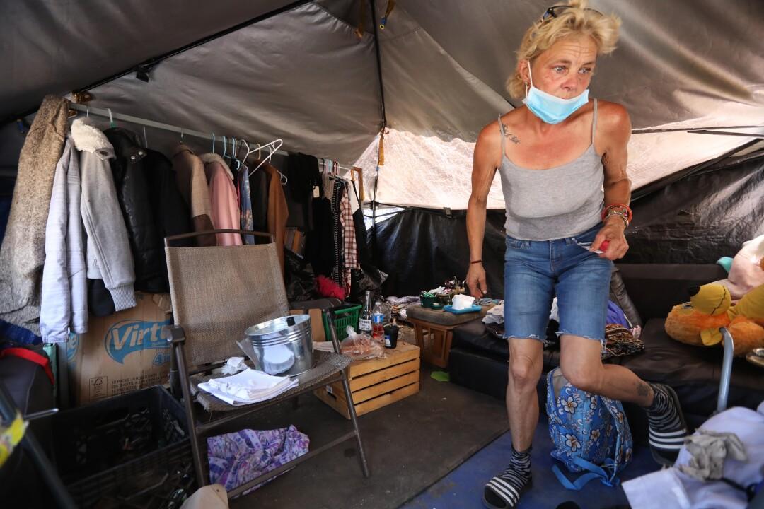 Genia Hope inside her encampment near the 105 and 710 freeways in Downey.