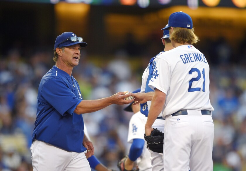 Dodgers Manager Don Mattingly takes starter Zack Greinke out of the game against the Cardinals in the seventh inning Sunday night.