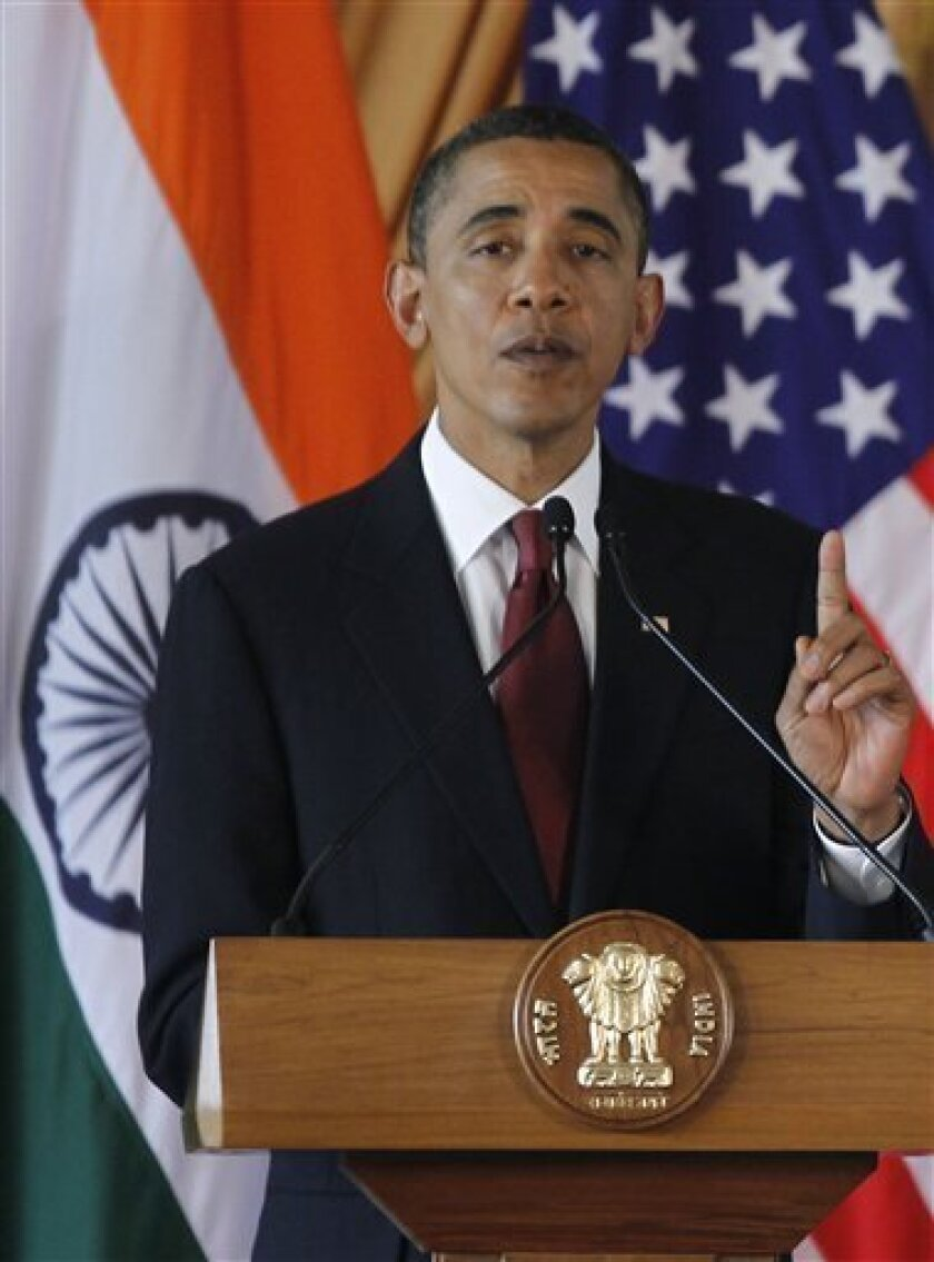 President Barack Obama answers a question during a joint news conference with India's Prime Minister Manmohan Singh, not pictured, at Hyderabad House in New Delhi, India, Monday, Nov. 8, 2010. (AP Photo/Charles Dharapak)