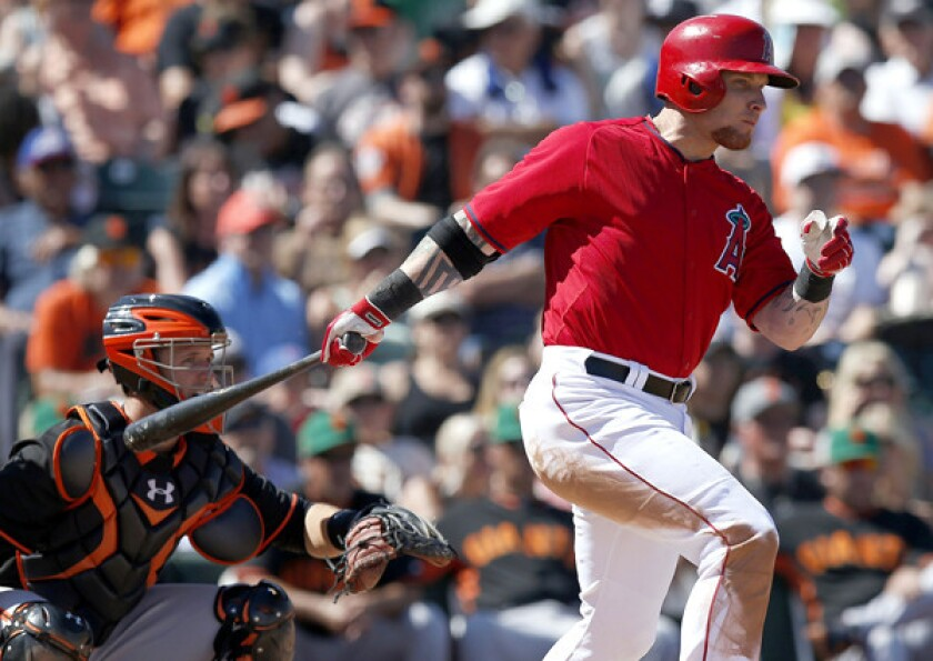Angels outfielder Josh Hamilton, connects for a single against the Giants in the fourth inning of an exhibition game on Monday.