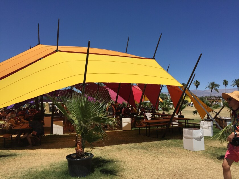 Tent in the shade terrace at Coachella Valley Music and Arts Festival where daily 12-step meetings are held for concert-goers who are in recovery from alcohol or drug addiction.