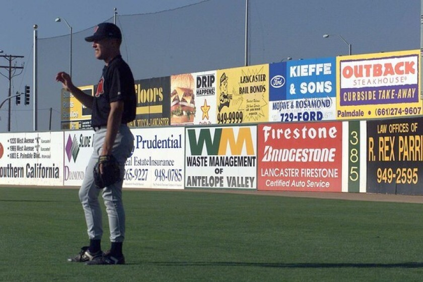 Advertisements add a touch of color to the outfield walls at the JetHawks' stadium in Lancaster