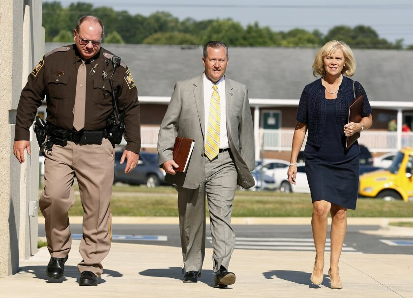 Mike Hubbard and Susan Hubbard walk to the Lee County Justice Center to start the second week of the ethics trial of Alabama Speaker Mike Hubbard on Tuesday, May 31, 2016, in Opelika, Ala. (Todd J. Van Emst/Opelika-Auburn News via AP, Pool)