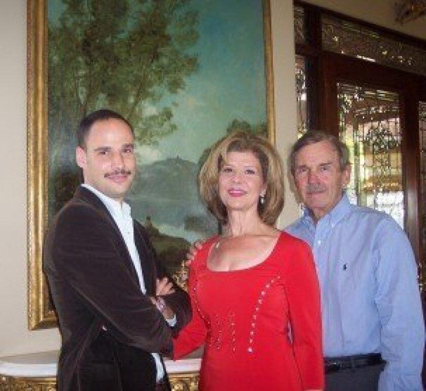 "(L-R) Dr. Ariel Plotek, Demi Rogozienski, Frank Rogozienski with Corot's ""Fisherman"" in the background. Photo by Diane Welch"