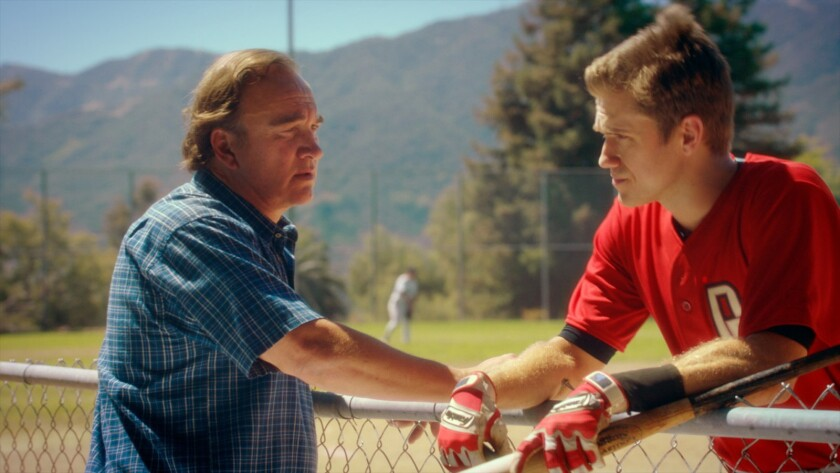 """Jim Belushi, left, and Aaron Tveit in """"Undrafted."""""""